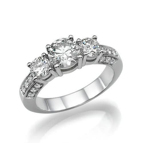 IMPRESSIVE TRIO-LOGY DIAMOND RING